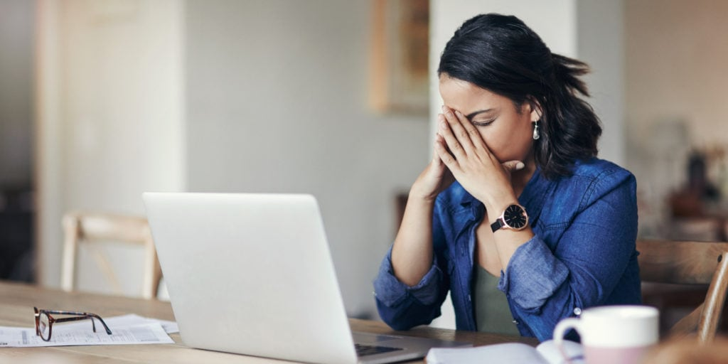 woman stressing out over google search results